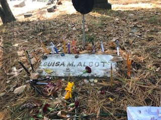 The+grave+of+Louisa+May+Alcott+is+covered+with+flowers+and+pencils+to+honor+the+great+writer.+