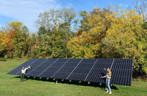 Lulu Hart and Olivia Selby embrace the new solar panels on RHS campus.