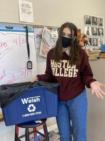 Eleanor Butler, Co-president of the environmental club wonders why there is a black plastic bag over classroom recycling bins this year.  Butler assumes trash and recycling are being thrown out together.