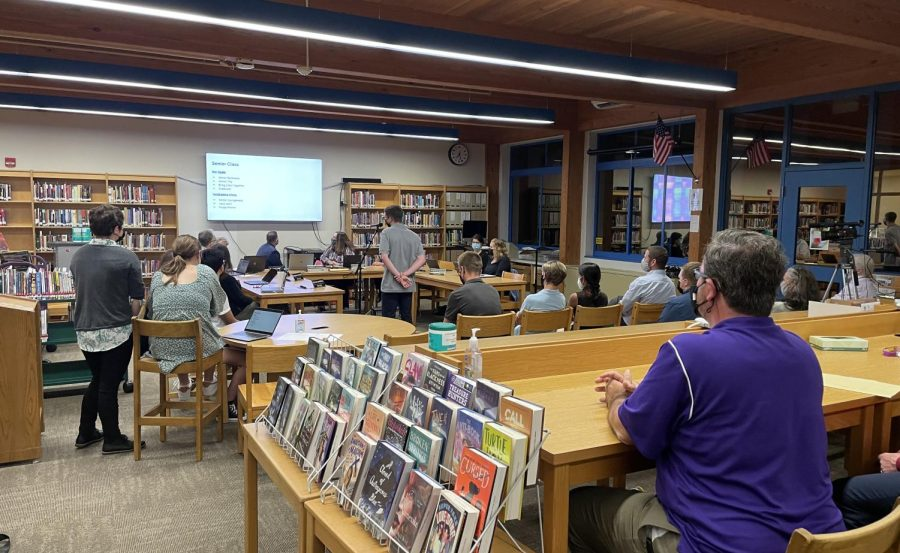 Student Council President, Riley LeHane at left, looks on as Senior class president, Matthew Raccuia at center, presents some of his ideas and goals for the new school year. Student Council Advisor Mr. Moor, (right) watches the presentation.