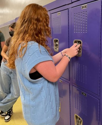 Joey Dull, class of 2022, accesses her locker to obtain her laptop. Over the summer, the RHS staff placed the MacBooks in lockers for us to receive when we arrive at the school. However, some students--especially those new to our district--- had some initial trouble actually getting their tech up and running.